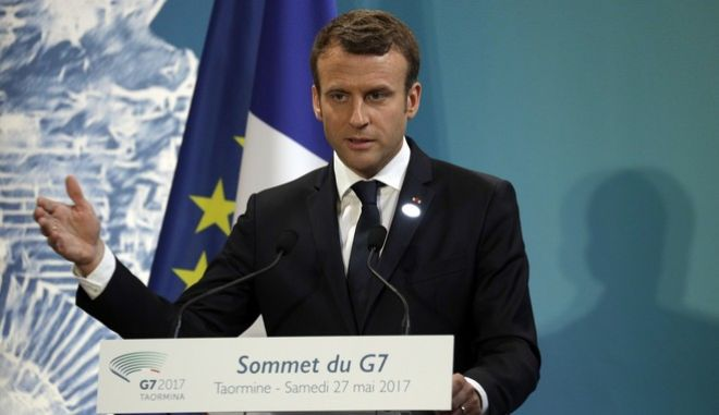 French President Emmanuel Macron speaks during a G7 closing news conference in the Sicilian town of Taormina, Italy, Saturday, May 27, 2017. (AP Photo/Andrew Medichini)