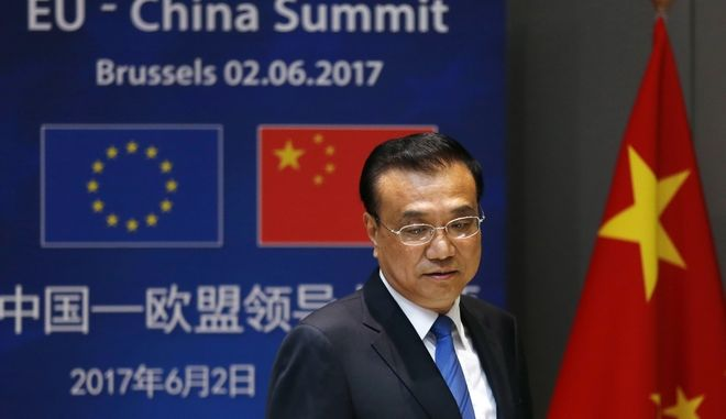 Chinese Premier Li Keqiang arrives for a round table meeting at an EU-China summit in Brussels, on Friday, June 2, 2017. (Francois Lenoir, Pool Photo via AP)