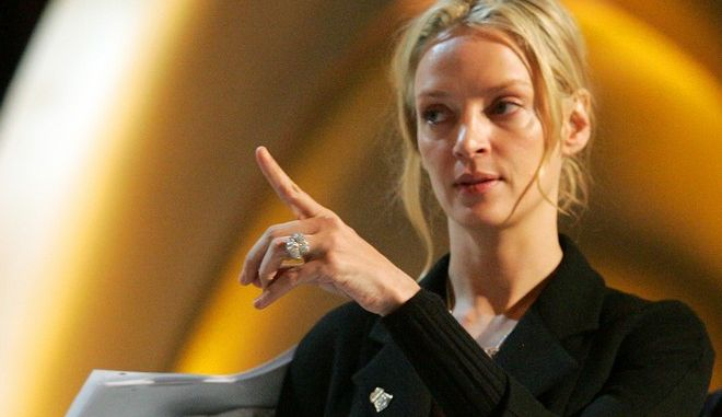 Actress Uma Thurman and stage manager Gary Hood rehearse at the Kodak Theatre for the 78th Annual Academy Awards in Los Angeles, Saturday, March 4, 2006. (AP Photo/Chris Carlson)