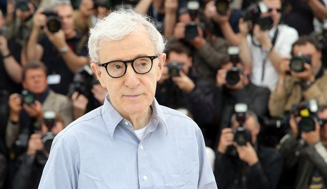 FILE - In this Wednesday, May 11, 2016, file photo, director Woody Allen poses for photographers during a photo call for the film Cafe Society, at the 69th international film festival, Cannes, southern France. Allens first small-screen series, Crisis in Sex Scenes, will debut Sept. 30, 2016. The comedy, set during the upheaval of the 1960s, focuses on a suburban family dealing with the chaos brought by a visitor. The cast includes Allen, Miley Cyrus and Elaine May. (AP Photo/Thibault Camus, File)