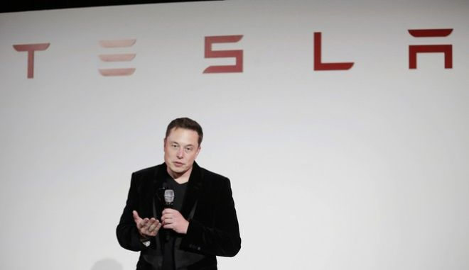 FILE - In this Tuesday, Sept. 29, 2015, file photo, Elon Musk, CEO of Tesla Motors Inc., talks during a news conference at the company's headquarters in Fremont, Calif. On Tuesday, Aug. 23, 2016, Tesla Motors said a new version of the Model S electric car is now the quickest production car in the world from zero to 60 miles per hour. The company says the Model S P100D sedan can go from stopped to 60 in 2.5 seconds. (AP Photo/Marcio Jose Sanchez, File)