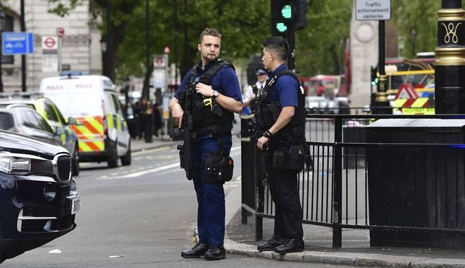 Armed police Officers  at the scene after a man was arrested following an incident at Whitehall in London, Thursday April 27, 2017.  London police arrested a man for possession of weapons Thursday near Britains Houses of Parliament. (Dominic Lipinski/PA via AP)