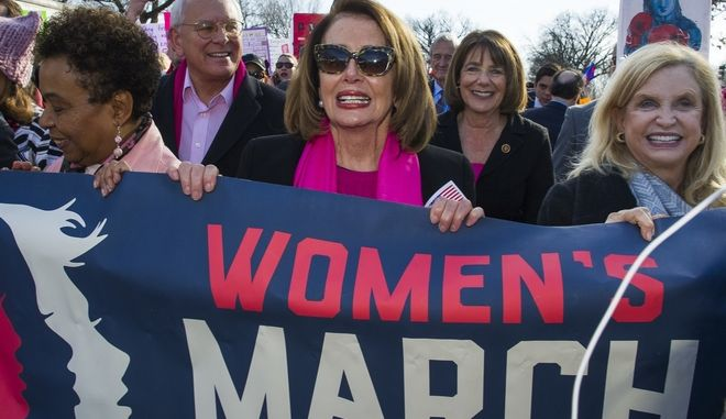 House Minority Leader Nancy Pelosi, D-Calif., center, Rep. Susan Davis, D-Calif, background center right, and Rep. Carolyn Maloney, D-N.Y., right, participate in the Women's March walk to the White House in Washington, Saturday, Jan. 20, 2018. On the anniversary of President Donald Trumps inauguration, people participating in rallies and marches in the U.S. and around the world Saturday denounced his views on immigration, abortion, LGBT rights, women's rights and more. (AP Photo/Cliff Owen)
