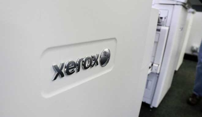 FILE - This Tuesday, May 24, 2016, file photo shows Xerox copiers at a store in North Andover, Mass. Billionaire investor Carl Icahn is calling for the removal of Xerox CEO Jeffrey Jacobson as the copier company reportedly seeks a deal with camera company Fujifilm. (AP Photo/Elise Amendola, File)