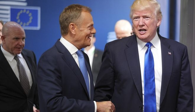 US President Donald Trump is greeted by European Council President Donald Tusk as he arrives at the Europa building in Brussels on Thursday, May 25, 2017. US President Donald Trump arrived in Belgium Wednesday evening and will attend a NATO summit as well as meet EU and Belgian officials. (AP Photo/Olivier Matthys)