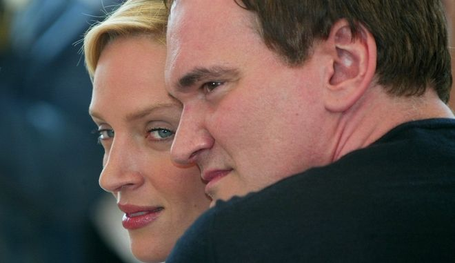 "American director Quentin Tarantino poses with American actress Uma Thurman during a photo call for their film"" Kill Bill vol. 2 "" shown out of competition, at the 57th Film Festival in Cannes, France, Sunday, May 16, 2004. Tarantino is the President of the 57th Cannes Film Festival. (AP Photo/Lionel Cironneau)"
