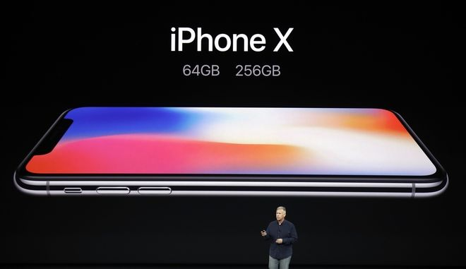 Phil Schiller, Apple's senior vice president of worldwide marketing, discusses features of the new iPhone X at the Steve Jobs Theater on the new Apple campus on Tuesday, Sept. 12, 2017, in Cupertino, Calif. (AP Photo/Marcio Jose Sanchez)