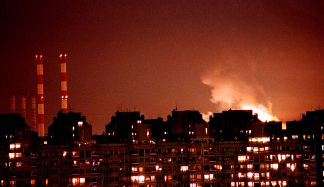 Flames from an explosion light up the Belgrade skyline near a power station, left, after NATO cruise missiles and warplanes attacked Yugoslavia late Wednesday, March 24, 1999 in response to Yugoslavia's failure to sign an agreement over the troubled southern province of Kosovo. (AP Photo/Dimitri Messinis)