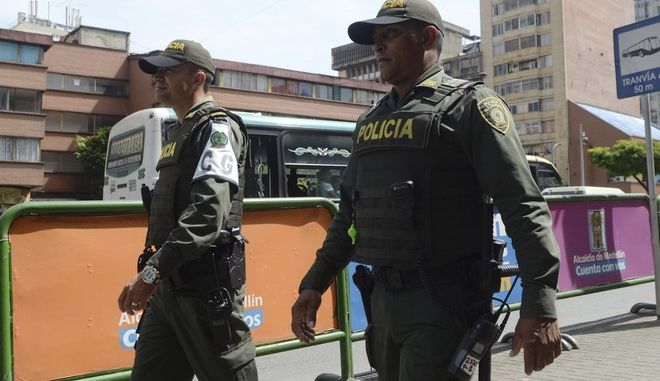 Police wearing bulletproof vests patrol in Medellin, Colombia, Friday, May 26, 2017. In response to Colombias largest illegal organization, the Gulf Clan, offering money for people to kill police, the military is sending troops to accompany police and officers are being encouraged to arrive to work in plainclothes, wear bulletproof vests and travel in pairs. (AP Photo/Luis Benavides)