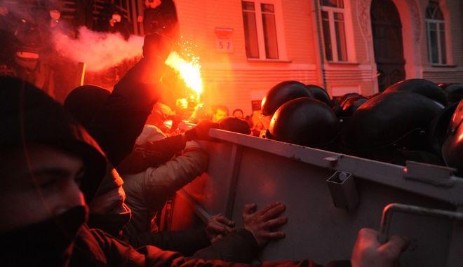 Riot police (Bekrut), defending the Kiev city council building, and protesters, clash at Bankova str, Kiev, Ukraine. December 1, 2013.