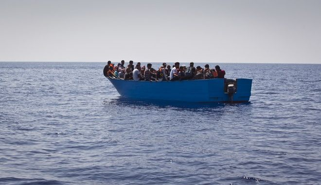 African migrants float on a wooden boat during a search and rescue operation conducted by SOS Mediterranee and MSF (Doctors Without Borders) NGOs, in the Mediterranean Sea, north of Libyan coast, Tuesday, Aug. 29, 2017. (AP Photo/Darko Bandic)