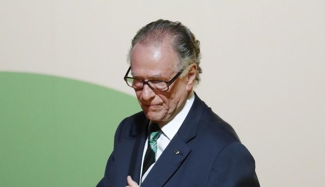 President of the Rio 2016 Organizing Committee Carlos Arthur Nuzman steps off stage after speaking during the Opening Ceremony of the International Olympic Committee Session at the 2016 Summer Olympics at the Cidade das Artes in Rio de Janeiro, Brazil, Monday, Aug. 1, 2016. (AP Photo/David Goldman)
