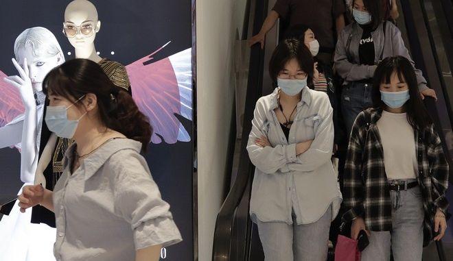 Γυναίκες με μάσκες σε μετρό στην Κίνα