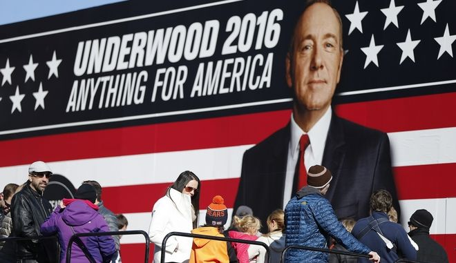 People stand in line waiting to enter the Underwood 2016 booth near the Peace Center where the CBS News Republican presidential debate will occur, Saturday, Feb. 13, 2016, in Greenville, S.C. Frank Underwood is a fictional character and the protagonist of the Netflix show  House of Cards. He is portrayed by Kevin Spacey. (AP Photo/John Bazemore)