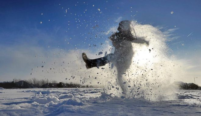 Archie Kirk plays in the snow as his school remained closed after heavy snow, in Brighton, southern England on December 3, 2010. (GLYN KIRK/AFP/Getty Images)