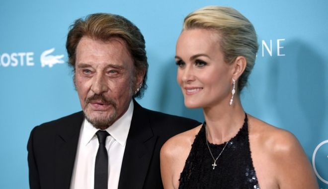 Johnny Hallyday, left, and Laeticia Hallyday arrive at the 17th Costume Designers Guild Awards at the Beverly Hilton Hotel on Tuesday, Feb. 17, 2015, in Beverly Hills, Calif. (Photo by Chris Pizzello/Invision/AP)
