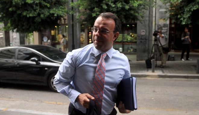 Christos Staikouras, arriving at the Finance ministry for a meeting with Giannis Stournaras and troika members. Minister for Finance in Athens, on July 01, 2013 /