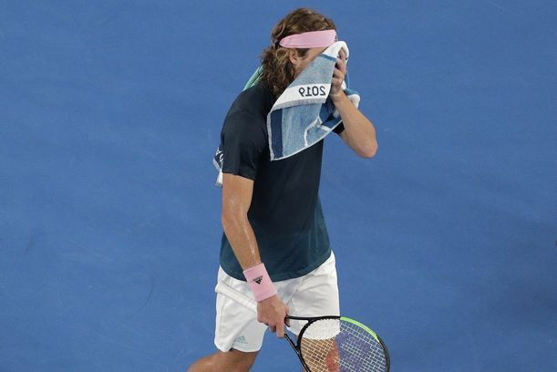Greece's Stefanos Tsitsipas walks to his chair during a break in his semifinal against Spain's Rafael Nadal at the Australian Open tennis championships in Melbourne, Australia, Thursday, Jan. 24, 2019. (AP Photo/Kin Cheung)