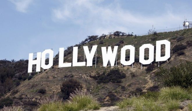 FILE - This file photo taken Friday Jan. 29,2010, shows the Hollywood sign near the top of Beachwood Canyon adjacent to Griffith Park in the Hollywood Hills of Los Angeles. KTLA-TV reported Wednesday, May 25, 2016, that YouTube prankster Vitaly Zdorovestskiy was arrested after climbing the sign. (AP Photo/Reed Saxon, File)