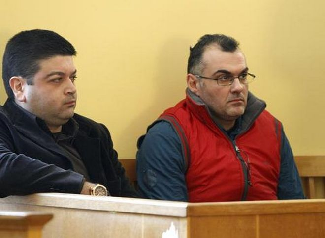Defendants Epaminondas Korkoneas (R) and Vassilis Saraliotis wait for their trial to start inside a court hall in Amfissa town, northwest of Athens January 20, 2010. Korkoneas and Saraliotis will face a court trial for the fatal shooting of teenager Alexandros Grigoropoulos on December 2008, which sparked the country's worst riots in decades.     REUTERS/Yiorgos Karahalis (GREECE - Tags: CRIME LAW)
