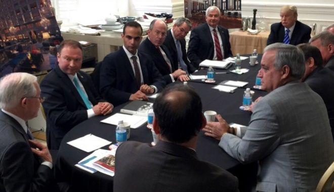 In this photo from President Donald Trump's Twitter account, George Papadopoulos, third from left, sits at a table with then-candidate Trump and others at what is labeled at a national security meeting in Washington that was posted on March 31, 2016. Papadopoulos, a former Trump campaign aide belittled by the White House as a low-level volunteer was thrust on Oct. 30, 2017, to the center of special counsel Robert Muellers investigation, providing evidence in the first criminal case that connects Trumps team and intermediaries for Russia seeking to interfere in the campaign. (Donald Trump's Twitter account via AP)