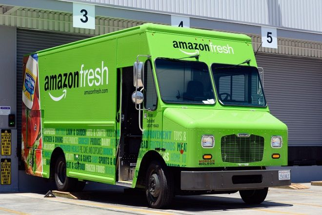 INGLEWOOD, CA - JUNE 27:  An Amazon Fresh truck sits parked at a warehouse on June 27, 2013 in Inglewood, California. Amazon began groceries and fresh produce delivery on a trial basis to select Los Angeles neighberhoods free of charge for Amazon Prime members. AmazonFresh lets you order groceries and have them delivered on the same day.  (Photo by Kevork Djansezian/Getty Images)