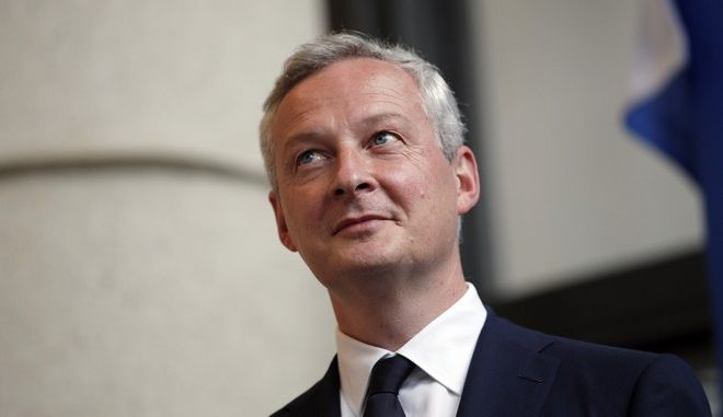 Newly named French economy minister, Bruno Le Maire, 48, left, listens to his predecessor, Michel Sapin, during an handover ceremony in Paris, France, Wednesday, May 17, 2017. The crucial Economy Ministry will be run by prominent conservative Bruno Le Maire, an important gesture to the right-wing Republicans party ahead of parliamentary elections next month.(AP Photo/Christophe Ena)