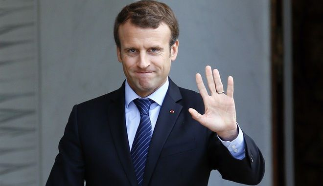 French President Emmanuel Macron waves as he accompanies U2P union leader Alain Griset after their meeting to start negotiations at the Elysee Palace, in Paris, Thursday, Oct.12, 2017. President Macron is launching step two of his campaign to rethink French labor law, this time focusing on unemployment benefits and job training. (AP Photo/Francois Mori)