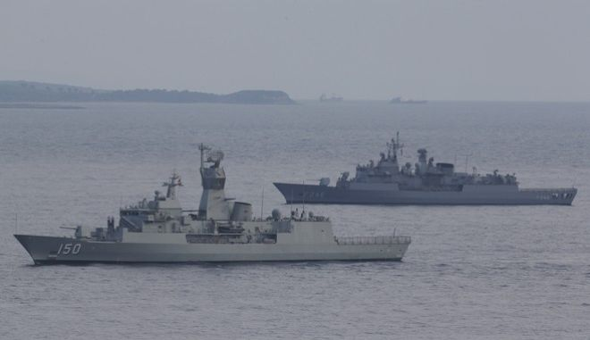 Turkish navy ships patrol as seen from the Helles Memorial in the Gallipoli peninsula, during a ceremony, Friday, April 24, 2015. The Helles Memorial, built in 1924 and bearing more than 21,000 names serves the dual function of Commonwealth battle memorial for the whole Gallipoli campaign and place of commemoration for many of those British and Commonwealth servicemen who died there and have no known grave. As world leaders gather with the descendants of the fighters in Gallipoli, the memories of one of the most harrowing campaigns of the 20th century have come surging back to life. The doomed Allied offensive to secure a naval route from the Mediterranean to Istanbul through the Dardanelles, and take the Ottomans out of the war, resulted in over 130,000 deaths on both sides. (AP Photo/Lefteris Pitarakis)