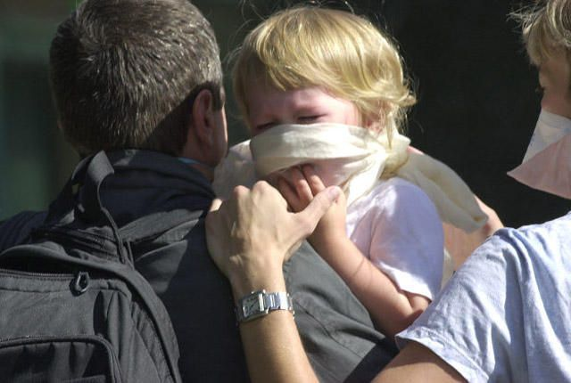Man carries child from scene of terrorist attack at the World Trade Center.    reaction