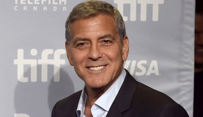 """FILE - In this Sept. 10, 2017 file photo, George Clooney attends a press conference for """"Suburbicon"""" at the Toronto International Film Festival in Toronto. Clooney will be the 46th recipient of the AFI Life Achievement Award. The American Film Institute announced Thursday that they will honor the actor-director at a gala tribute in June. (Photo by Chris Pizzello/Invision/AP, File)"""