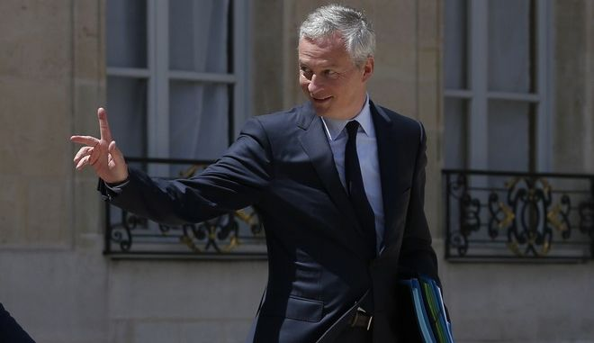 """French culture minister Francoise Nyssen, left, and Economy Minister Bruno Lemaire leave the weekly cabinet meeting, at the Elysee Palace, in Paris, Wednesday, June 14, 2017. France's government is presenting a bill on cleaning up political ethics after years of corruption scandals. But investigations are already haunting members of President Emmanuel Macron's new government. Justice Minister Francois Bayrou is unveiling the draft law on """"restoring trust"""" in politics Wednesday to the Cabinet. It's the first major legislation by Macron's administration. (AP Photo/Thibault Camus)"""