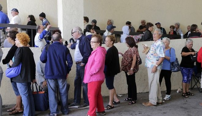 People wait in line for an application to apply for low income elderly housing at the Elderly Housing Development & Operations Corporation, Wednesday, April 19, 2017, in Miami Beach, Fla. (AP Photo/Lynne Sladky)