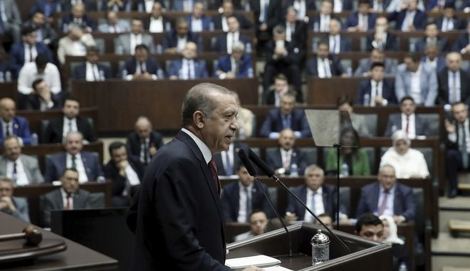 Turkey's President and the leader of ruling Justice and Development Party Recep Tayyip Erdogan addresses his supporters at the parliament in Ankara, Turkey, Tuesday, July 25, 2017. Erdogan has accused Israel of using terrorism as a pretext to take over holy sites in Jerusalem from Muslims and called on all Muslims to defend the holy sites by visiting Jerusalem at every occasion or by sending aid to Muslims there. (Presidential Press Service/Pool via AP)