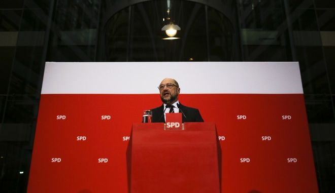 Social Democratic Party, SPD, chairman Martin Schulz addresses the media during a news conference after a board meeting at the  party's headquarter in Berlin, Germany, Monday, Dec. 4, 2017. (AP Photo/Markus Schreiber)