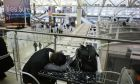 A passenger rests his head while waiting for a flight at JFK International Airport Friday, March 2, 2018, in New York. Airlines have cancelled many flights out of New York as a severe storm arrives in the northeast. (AP Photo/Mark Lennihan)