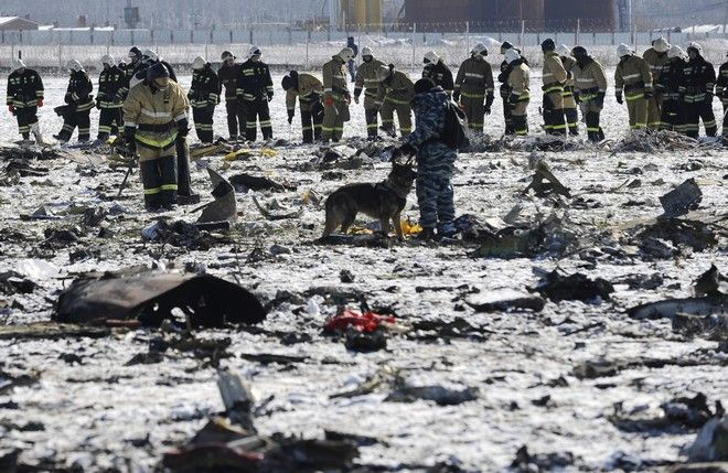 2016 AP YEAR END PHOTOS - Russian Police and Emergency Ministry employees investigate the wreckage of a crashed plane at the Rostov-on-Don airport, about 950 kilometers (600 miles) south of Moscow, Russia, on March 20, 2016. (AP Photo, File)