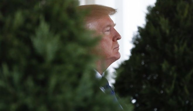 President Donald Trump waits outside the West Wing of the White House in Washington, Tuesday, Jan. 16, 2018, to greet Kazakhstan's President Nursultan Nazarbayev. (AP Photo/Carolyn Kaster)