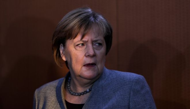 German Chancellor Angela Merkel arrives for a cabinet meeting of the German government at the chancellery in Berlin, Wednesday, Dec. 13, 2017. (AP Photo/Markus Schreiber)