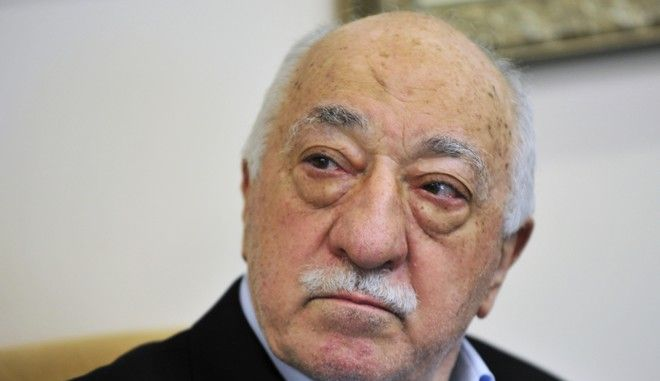 FILE - In this July 2016 file photo, Islamic cleric Fethullah Gulen speaks to members of the media at his compound, in Saylorsburg, Pa. Turkeys justice minister on Thursday, Oct. 27, 2016, pressed the U.S. to extradite Gulen who he accuses of orchestrating the July failed coup attempt or risk seriously harming relations between the two countries.  (AP Photo/Chris Post, File)