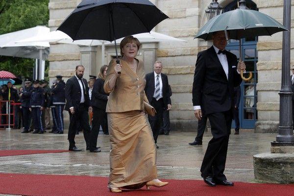 German chancellor Angela Merkel, left, and her husband Joachim Sauer arrive for the opening of the Bayreuth Opera Festival in Bayreuth, Germany, Tuesday, July 25, 2017. (AP Photo/Matthias Schrader)