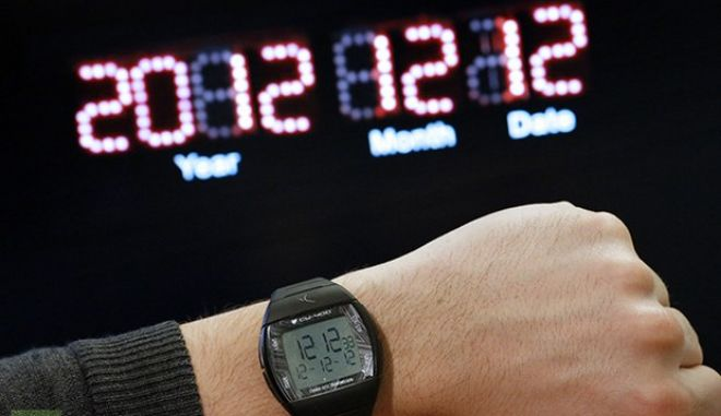 "A picture taken on December 11, 2012 in Paris shows a watch on a person's wrist reading the time ""12:12"" and the date ""12-12-12"" for December 12, 2012, in front of a digital clock reading ""December 12, 2012"". With a rush to buy lucky lottery tickets and prayers for peace and harmony, people worldwide will mark once-per-century 12/12/12 lineup with humor, hope and a hint of mischief.  AFP PHOTO THOMAS COEX"
