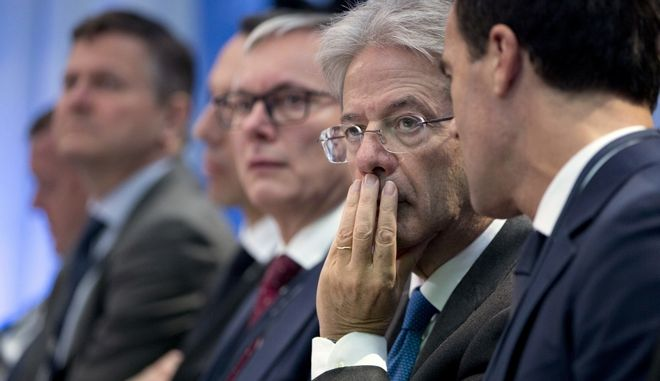 Italian Prime Minister Paolo Gentiloni, second right, attends a round table meeting at an EU summit in Goteborg, Sweden on Friday, Nov. 17, 2017. European Union leaders warned Britain Friday that it must do much more to convince them that Brexit talks should be broadened to future relations and trade from December. (AP Photo/Virginia Mayo)