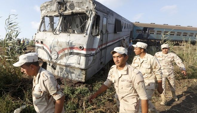 Army attend the scene of a train collision just outside Egypts Mediterranean port city of Alexandria, Friday, Aug. 11, 2017, two trains collided killing dozens of people and injuring over 100 in the countrys deadliest rail accident in more than a decade. (AP Photo/Ravy Shaker)