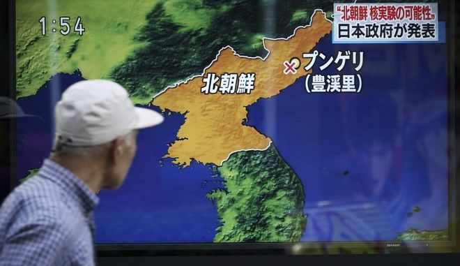 A man walks past a TV news on screen reporting North Korea's a possible nuclear test in Tokyo Sunday, Sept. 3, 2017. South Korea's military said Sunday that North Korea is believed to have conducted its sixth nuclear test after it detected a strong earthquake, hours after Pyongyang claimed that its leader has inspected a hydrogen bomb meant for a new intercontinental ballistic missile. (AP Photo/Eugene Hoshiko)