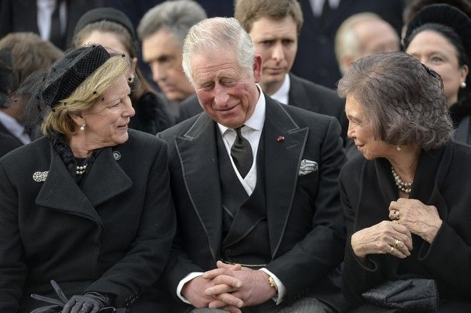 Greece's Queen Anne Marie, left, talks to former Spanish Queen Sofia, right, and Britain's Prince Charles while attending the funeral ceremony in tribute to late Romanian King Michael in Bucharest, Romania, Saturday, Dec. 16, 2017. Tens of thousands of Romanians joined the European royals on Saturday to pay their respects to late King Michael as a state funeral got underway. Michael, who ruled Romania twice before being forced to abdicate by the communists in 1947, died at the age of 96 in Switzerland this month. (AP Photo/Andreea Alexandru)