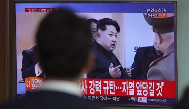 """A man watches a TV news program showing a file footage of North Korean leader Kim Jong Un, at Seoul Train Station in Seoul, South Korea, Wednesday, April 5, 2017. North Korea fired a ballistic missile into its eastern waters Wednesday, U.S. and South Korean officials said, amid worries the North might conduct banned nuclear or rocket tests ahead of the first summit between President Donald Trump and his Chinese counterpart Xi Jinping this week. The letters read on top left """"North Korea fired a ballistic missile."""" (AP Photo/Lee Jin-man)"""