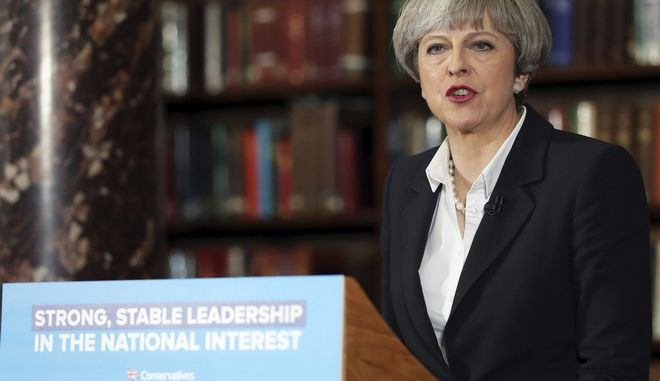 Britain's Prime Minister Theresa May makes a speech at the Royal United Services Institute for Defence and Security Studies in central London  while on the General Election campaign trail. Monday June 5, 2017. The British electorate will vote in a general election on Thursday. (Andrew Matthews/PA via AP)