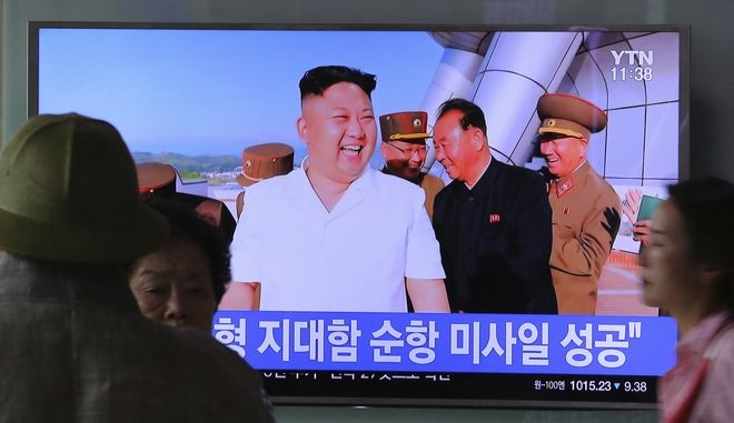 """A TV news program shows a photo published in North Korea's Rodong Sinmun newspaper of North Korean leader Kim Jong Un, at Seoul Railway station in Seoul, South Korea, Friday, June 9, 2017. North Korea said Friday it has tested a new type of cruise missile that could strike U.S. and South Korean warships """"at will"""" if it is attacked, in an apparent reference to the projectiles detected by Seoul when they were launched a day earlier. The signs read """" Successful launch of cruise missile."""" (AP Photo/Ahn Young-joon)"""