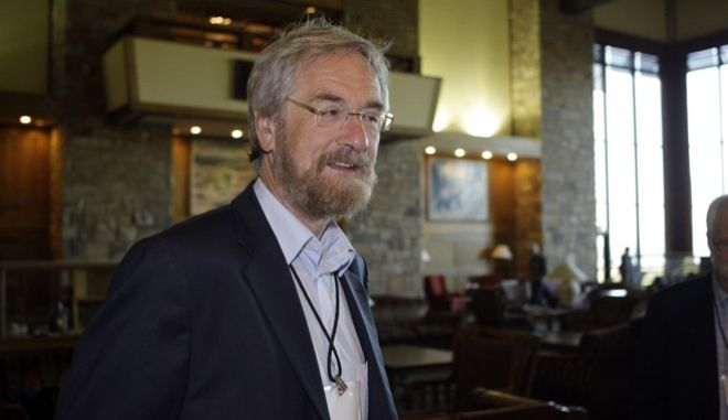 Peter Praet, executive board member of the European Central Bank, arrives at the morning session of the Economic Policy Symposium at Jackson Hole in Moran, Wyo., Friday, Saturday, Aug. 27, 2011. (AP Photo/Reed Saxon)